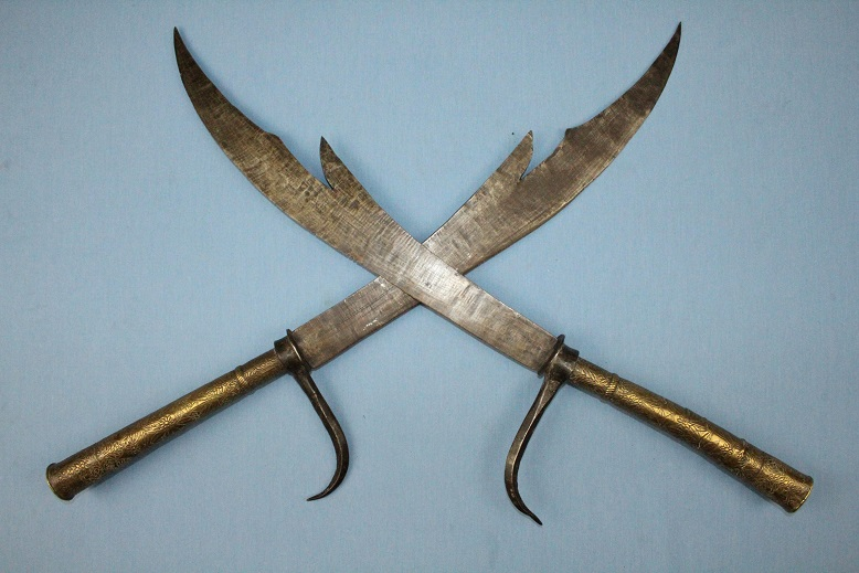 A rare pair of Hgao heads Samrit repousse alloy Elephant goad combinations Early Thailand/Laos www.swordsantiqueweapons.com